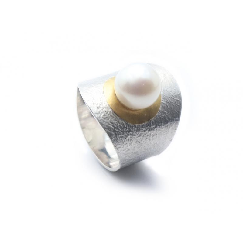 Anell plata, or i perla