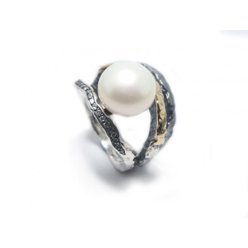 Anell plata, or, circonites i perla